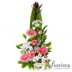 Centrotavola di gerbere rosa e fiori bianchi