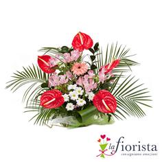 Composizione funebre di Anthurium rossi e fiori rosa